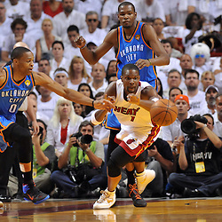 Jun 17, 2012; Miam, FL, USA; Miami Heat power forward Chris Bosh (1) and Oklahoma City Thunder point guard Russell Westbrook (0) go for a loose ball during the first quarter in game three in the 2012 NBA Finals at the American Airlines Arena. Mandatory Credit: Derick E. Hingle-US PRESSWIRE