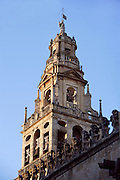 The Tower; 1593; Great Mosque, Cordoba, Andalusia, Spain; built by Hernán Ruiz the younger onto the minaret to accommodate the bells and the clock; because of earth tremors, an outer strengthening wall was built later, concealing what was left of the original minaret; the Archangel Raphael, guardian angel of Cordoba stands on the top of the third storey added still later. Picture by Manuel Cohen