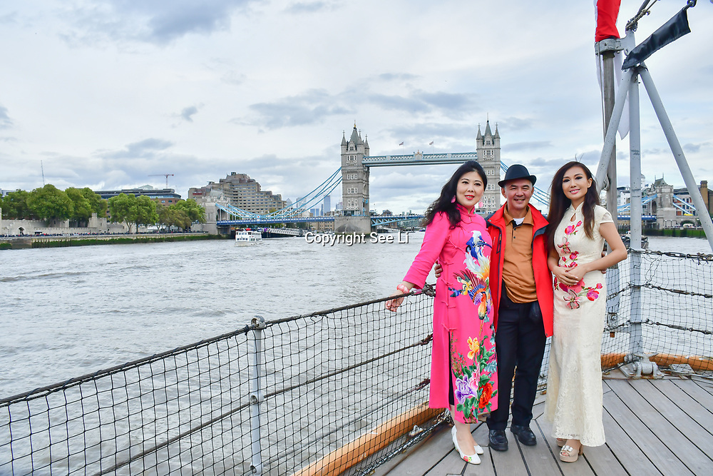 """See Li and Chinese Soprano 王蓓蓓,Wang Beibei (L) and  朱珍,Jane Maria sings 我和我的祖国,Me and my country to celebration of the 70th China National Day 2019 and a Chinese """"Qipao"""" flash mob, London, 28 September 2019, UK."""