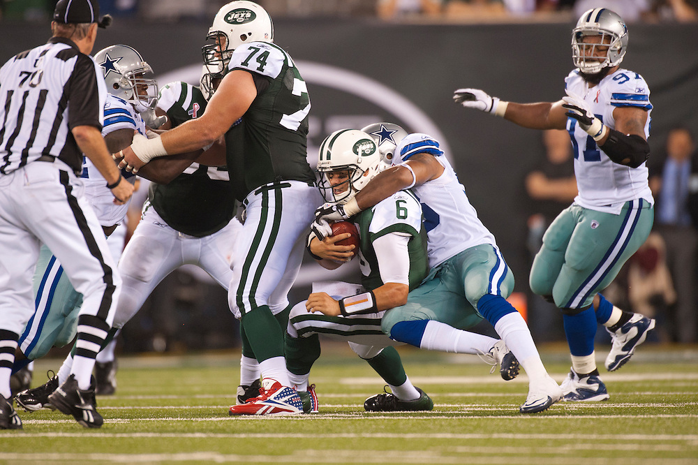 EAST RUTHERFORD, NJ - SEPTEMBER 11: Mark Sanchez #6 of the New York Jets is sacked during the game against the Dallas Cowboys at MetLife Stadium on September 11, 2011 in East Rutherford, New Jersey. The Jets defeated the Cowboys 27 to 24. (Photo by Rob Tringali) *** Local Caption *** Mark Sanchez
