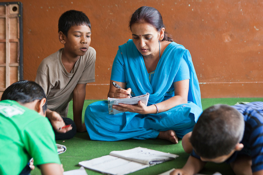 Taria, a Nepalese social worker facilitates a education session with street children during a class for 9-12 year olds in the Voice of Children rehabilitation center in Kathmandu, Nepal.  The not-for-profit organisation supports street children and those who are at risk of sexual abuse through educational and vocational training opportunities, health services and psychosocial counseling.