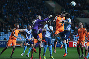 Colchester United goalkeeper Elliott Parish (33) punches clear during the Sky Bet League 1 match between Coventry City and Colchester United at the Ricoh Arena, Coventry, England on 29 March 2016. Photo by Simon Davies.