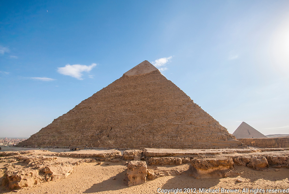 In the foreground is the Chephren Pyramid.  In the background is the Mykerinos Pyramid.  In Giza, Egypt.