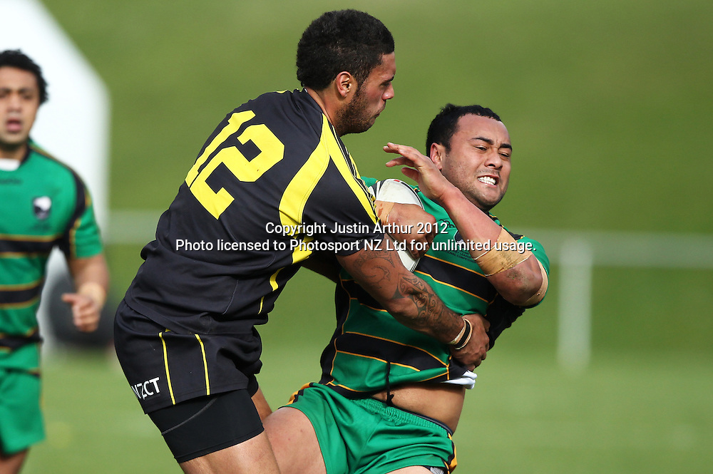 Vipers Richard Graham is tackled by Tim Noble during the Pirtek National Rugby League Premiership 2012 - Wellington Orcas v Central Vipers at Porirua Park, Porirua, New Zealand on 25 August 2012. Photo: Justin Arthur / photosport.co.nz