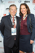 David Anderson and guest on the red carpet during opening night of the 25th Anniversary New Orleans Film Festival; Opening night film is 'Black and White' directed by Mike Binder