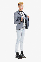 Teenage boy in smart casuals over gray background