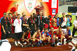 BANGKOK, THAILAND - Thailand. Thursday, July 24, 2003: Liverpool team with the GSM Advance Cup after beating Thailand 3-1 during a preseason friendly match at the Rajamangala National Stadium. (Pic by David Rawcliffe/Propaganda)