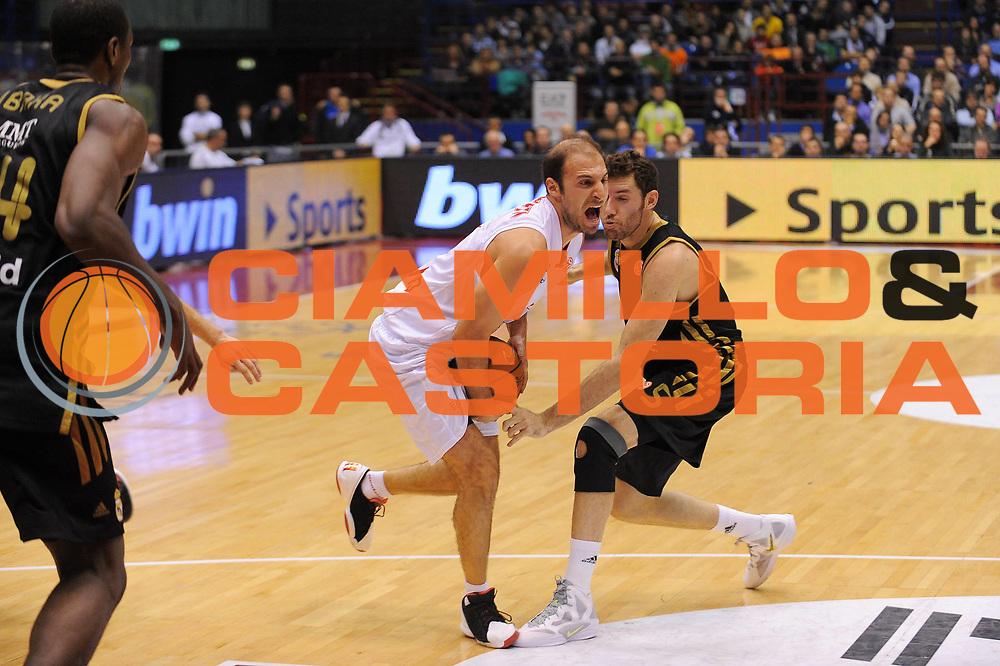 DESCRIZIONE : Milano Eurolega 2011-12 EA7 Emporio Armani Milano Real Madrid<br /> GIOCATORE : Jacopo Giachetti<br /> CATEGORIA : Palleggio Penetrazione<br /> SQUADRA : EA7 Emporio Armani Milano<br /> EVENTO : Eurolega 2011-2012<br /> GARA : EA7 Emporio Armani Milano Real Madrid<br /> DATA : 01/12/2011<br /> SPORT : Pallacanestro <br /> AUTORE : Agenzia Ciamillo-Castoria/A.Dealberto<br /> Galleria : Eurolega 2011-2012<br /> Fotonotizia : Milano Eurolega 2011-12 EA7 Emporio Armani Milano Real Madrid<br /> Predefinita :