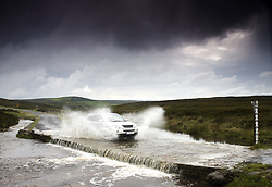 July 21, 2019 - Car Driving Down Flooded Road, Yorkshire, England (Credit Image: © John Short/Design Pics via ZUMA Wire)