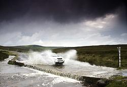 July 21, 2019 - Car Driving Down Flooded Road, Yorkshire, England (Credit Image: © John Short/Design Pics via ZUMA Wire)