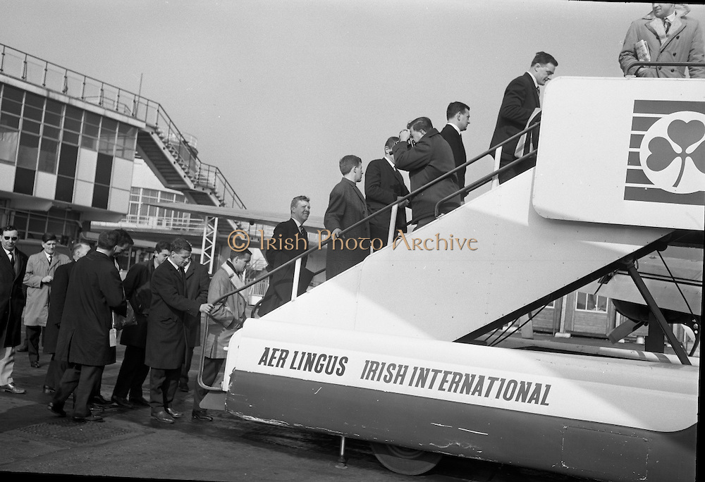 Irish Rugby team, which will play Wales..1965..11.03.1965..03.11.1965..11th March 1965..After wins against England (5-0), and Scotland (16-6). Ireland had high hopes of winning the Triple Crown in the decider against Wales in Cardiff. Wales had also beaten both England and Scotland...Image shows the Irish Rugby team,boarding their aircraft at Dublin Airport as the leave for Cardiff.
