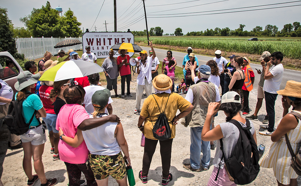 "Members of CADA and supporters in front of the Whitney Plantation, on the first day  of the Coalition Against Death Alley's 5 day march. The Coalition Against Death Alley (CADA), is a group of Louisiana-based residents and members of various local and state organizations, is calling for a stop to the construction of new petrochemical plants and the passing of stricter regulations on existing industry in the area that include the groups RISE St. James, Justice and Beyond, the Louisiana Bucket Brigade, 350 New Orleans, and the Concerned Citizens of St. John.  Louisiana's Cancer Alley, an 80-mile stretch along the Mississippi River, is also known as the ""Petrochemical Corridor,"" where there are over 100 petrochemical plants and refineries."