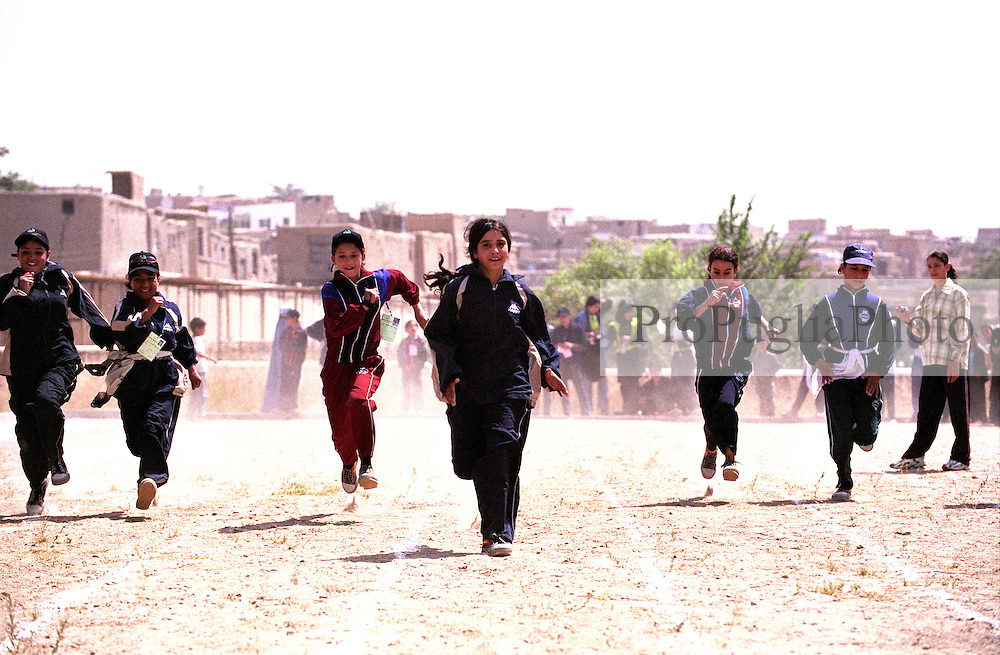 KABUL 24 August 2005.Afghan girls running for the 25 Meters competition at Bagh-e-Zanama, in occasion of the Special Olympics games for disable...On 23-25 August 2005, Special Olympics Afghanistan held its first national Games at Olympic Stadium in Kabul. More than 300 athletes, including 80 female athletes, experienced a taste of happiness and achievement for the first time in their lives. They competed in athletics, bocce and football (soccer). Because of cultural restrictions, males and females competed at separate venues.