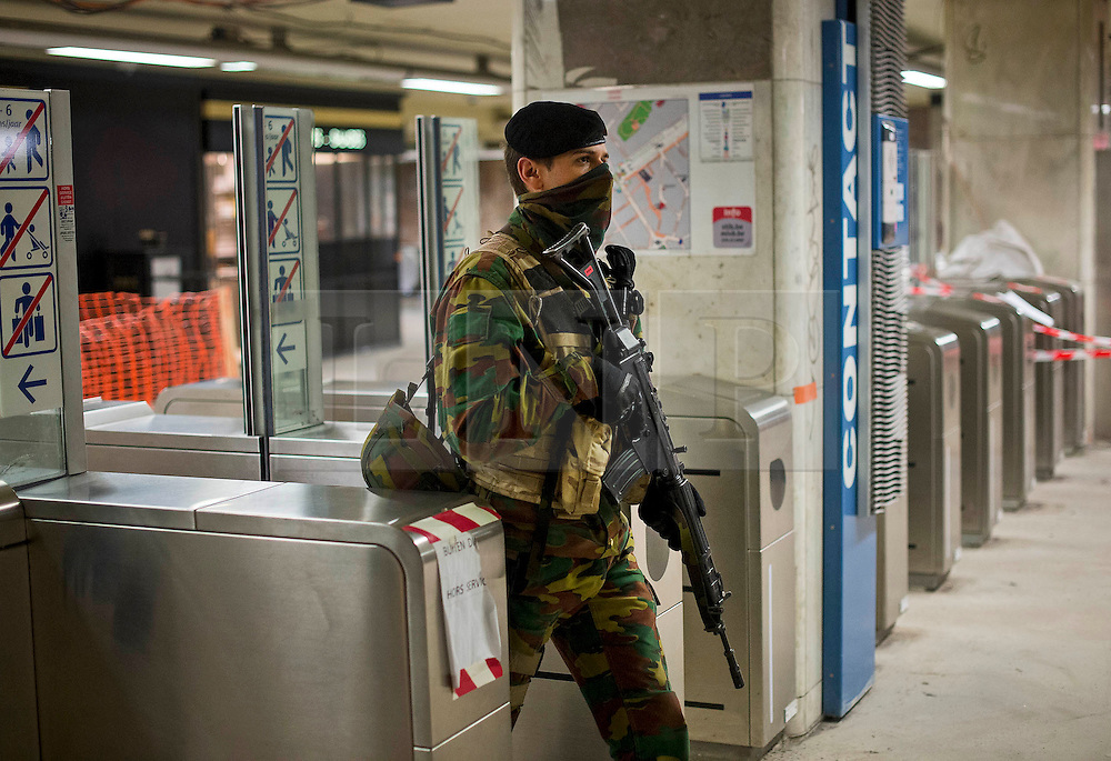© Licensed to London News Pictures. 25/11/2015. Brussels, Belgium. Armed Belgian military guarding the platform at Louise Metro station in Central Brussels where the Metro transport system is now running and some schools have reopened following closure due to security fears. The Belgian capital has been on lockdown and the highest security alert due to fears of a terrorist attack following the recent attacks in Paris. Photo credit: Ben Cawthra/LNP