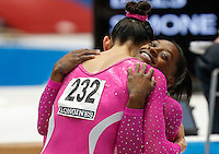 Kyla Ross of the U.S. greats compatriot Simones Biles during the women's all around final at the Artistic Gymnastics World Championships in Antwerp, Belgium, 04 October 2013.