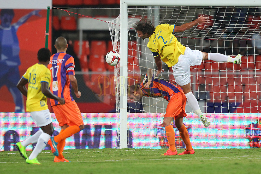 Cedric Hengbart of Kerala Blasters FC climbs high on Adrian Mutu of FC Pune City during match 17 of the Hero Indian Super League between FC Pune City<br /> and Kerala Blasters FC held at the Shree Shiv Chhatrapati Sports Complex Stadium, Pune, India on the 30th October 2014.<br /> <br /> Photo by:  Ron Gaunt/ ISL/ SPORTZPICS