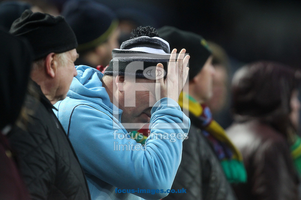This traveling Norwich fans expression says it all after his side concede a 2nd goal during the Barclays Premier League match at Villa Park, Birmingham<br /> Picture by Paul Chesterton/Focus Images Ltd +44 7904 640267<br /> 06/02/2016