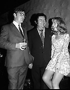 Ballybunion Festival. (F11).1973..24.05.1973..05.24.1973..24th May 1973..A press reception was held last night in the Old Shieling Hotel,Raheny,Dublin to announce the forthcoming Ballybunion Festival..Image of T.J.O'Sullivan discussing the forthcoming Ballybunion Festival with this happy couple.