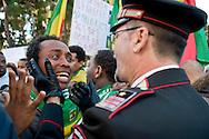 Roma 19 Novembre 2013<br /> Circa duecento manifestanti davanti l'ambasciata saudita a Roma per protestare contro l'  uccisione di migranti etiopi in Arabia Saudita. I manifestanti etiopi accusa il  Regno dell'Arabia Saudita  di aver ordinato l'espulsione di 23.000 etiopi e le forze dell'ordine di avere ucciso e stuprato  molti immigrati.Un maresciallo dei carabinieri accarezza un manifestante che piange per l'uccisione dei suoi parenti in Arabia Saudita<br /> Rome 19 November 2013<br /> Around two  hundred angry protesters gathered outside the Saudi Embassy in Roma to protest against the alleged killing of Ethiopian migrants in Saudi Arabia. Some demonstrators also alleged injustice, rape and torture against their countrymen. A non-commissioned officer of the carabinieri caresses a protester who weeps for the killing of his relatives in Saudi Arabia