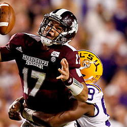 November 10, 2012; Baton Rouge, LA, USA;  LSU Tigers defensive end Sam Montgomery (99) sacks Mississippi State Bulldogs quarterback Tyler Russell (17) during the second half of a game at Tiger Stadium.  LSU defeated Mississippi State 37-17. Mandatory Credit: Derick E. Hingle-US PRESSWIRE