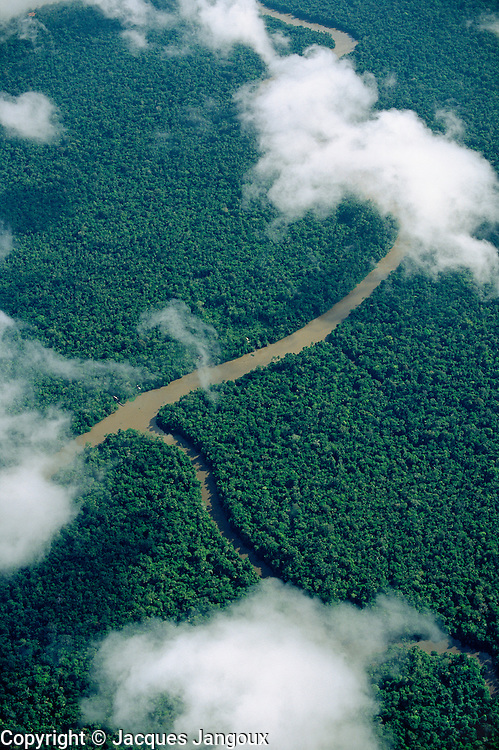 Aerial of rainforest seen from above small clouds in Amazon estuary region, Brazil, Para.