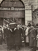Funeral of doctor Orestano, killed by members of Banda Giuliano Salvatore, a group of bandits on the run and wanted by the police, black and white photograph from the exhibition No Mafia Memorial, in Palermo, Sicily, Italy. Salvatore Giuliano was a bandit wanted by the police who worked with a gang of men attacking the police and running the black market. The No Mafia Memorial explores the growth and history of the mafia, and its impact on the Sicilian population. Picture by Manuel Cohen