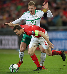 Switzerland's Stephan Lichtsteiner (left) and Northern Ireland's George Saville battle for the ball during the FIFA World Cup Qualifying second leg match at St Jakob Park, Basel.