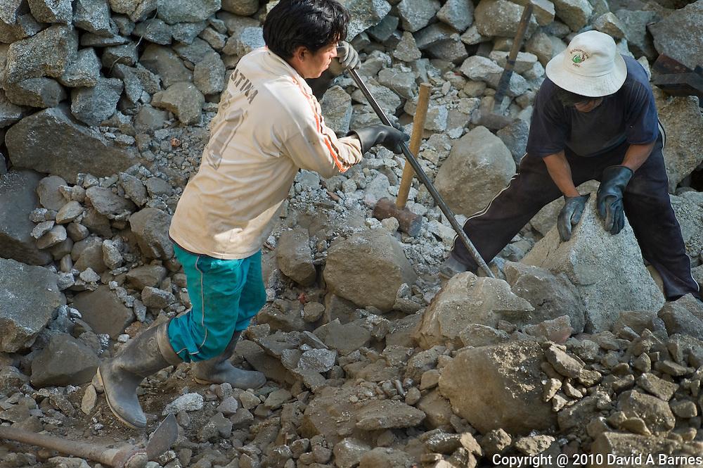 Men breaking up rock, Aguas Calientes, Peru