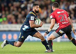Highlanders' Lima Sopoaga, left, looks to beat Crusaders' Bryn Hall in the Super Rugby match, Forsyth Barr Stadium, Dunedin, New Zealand, Saturday, March 17, 2018. Credit:SNPA / Adam Binns ** NO ARCHIVING**