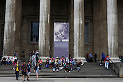 Visitors beneath the columns of London's British Museum