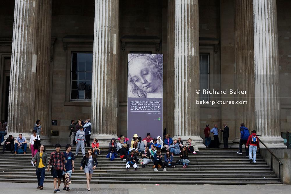 Visitors beneath the columns of London's British Museum