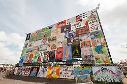 © Licensed to London News Pictures. 27/06/2015. Pilton, UK.  The Wall of Protest at Glastonbury Festival 2015 on Saturday Day 4 of the festival.  This years headline acts include Kanye West, The Who and Florence and the Machine, the latter being upgraded in the bill to replace original headline act Foo Fighters. Photo credit: Richard Isaac/LNP