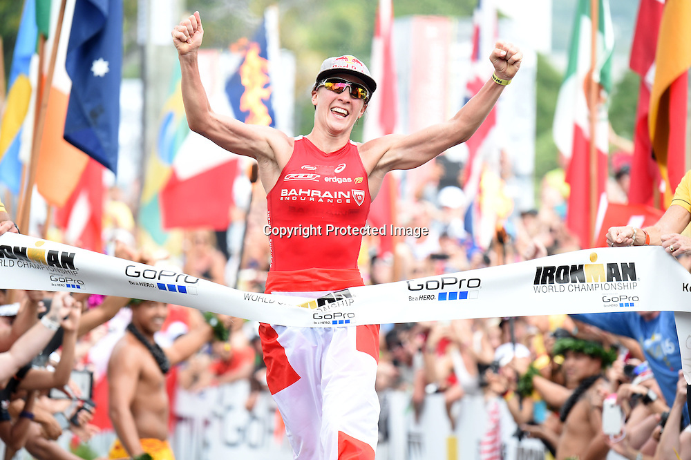 Daniela Ryf of Switzerland celebrates winning the 2015 IRONMAN World Championship presented by GoPro on October 10th 2015 in Kailua Kona, Hawaii. Photo: DELLY CARR