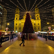 BUDAPEST, HUNGARY - DECEMBER 07:  Children skate in front of Saint Stephen Basilica on December 7, 2017 in Budapest, Hungary. The traditional Christmas market and lights will stay until 31st December 2017.