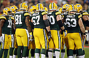 The Green Bay Packers offense huddles and calls a play during the 2015 NFL week 3 regular season football game against the Kansas City Chiefs on Monday, Sept. 28, 2015 in Green Bay, Wis. The Packers won the game 38-28. (©Paul Anthony Spinelli)