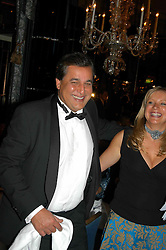 DR HASNAT KHAN and EMMA SCANLAN Executive Director of Chain of Hope at the Chain of Hope Autumn Ball Fiesta held at The Dorchester, Park Lane, London on 6th October 2004.