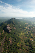 Aerial of mountain ridge covered in forest. South East of Dambulla