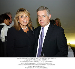 SIR NICHOLAS LLOYD and his wife EVE POLLARD at a party in London on 11th September 2003.PMI 74