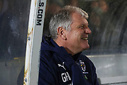 AFC Wimbledon manager Glyn Hodges sitting in dug out and smiling during the EFL Sky Bet League 1 match between AFC Wimbledon and Burton Albion at the Cherry Red Records Stadium, Kingston, England on 28 January 2020.