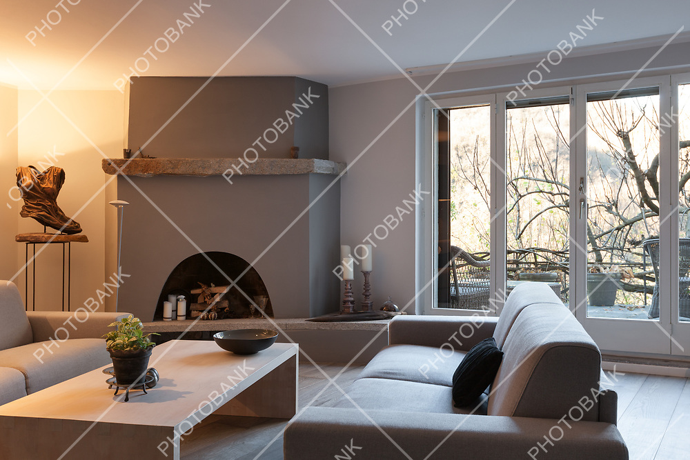 Interior of house, modern comfortable living room with fireplace