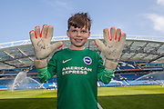 Young Albion fan Harry Dean celebrates his 8th Birthday showing off the gloves he was given by his hero, Brighton goalkeeper David Stockdale, before the Sky Bet Championship match between Brighton and Hove Albion and Burnley at the American Express Community Stadium, Brighton and Hove, England on 2 April 2016. Photo by Bennett Dean.