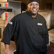 Executive Chef Freddie Greene photographed in his kitchen at the Wyndham Garden Dallas North. On-location executive portrait by William Morton.