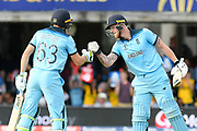 50 - Jos Buttler of England is congratulated by Ben Stokes of England after scoring a half century during the ICC Cricket World Cup 2019 Final match between New Zealand and England at Lord's Cricket Ground, St John's Wood, United Kingdom on 14 July 2019.