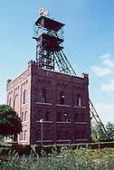 Nederland, Kerkrade, 19930810.  <br /> Mijnschacht.<br /> achter het gebouw van het CBS in Heerlen staat nog een in baksteen uitgevoerde Malakowschachtblok van de Oranje-Nassau I met ophaalinstallatie. Het is nu een mijnmuseum.<br /> industrieel erfgoed, steenkool/mijnbouw<br /> <br /> Deze foto is onderdeel van een uitgebreide serie van meer dan 200 industrieel erfgoed objecten. Voor een deel gepubliceerd in het boek van Teleac: Industrieel Erfgoed.<br /> (C)