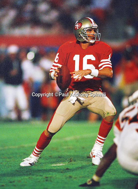 San Francisco 49ers quarterback Joe Montana (16) drops back to pass during the NFL Super Bowl XXIII football game against the Cincinnati Bengals on Jan. 22, 1989 in Miami, Fla. The 49ers won the game 20-16. (©Paul Anthony Spinelli)