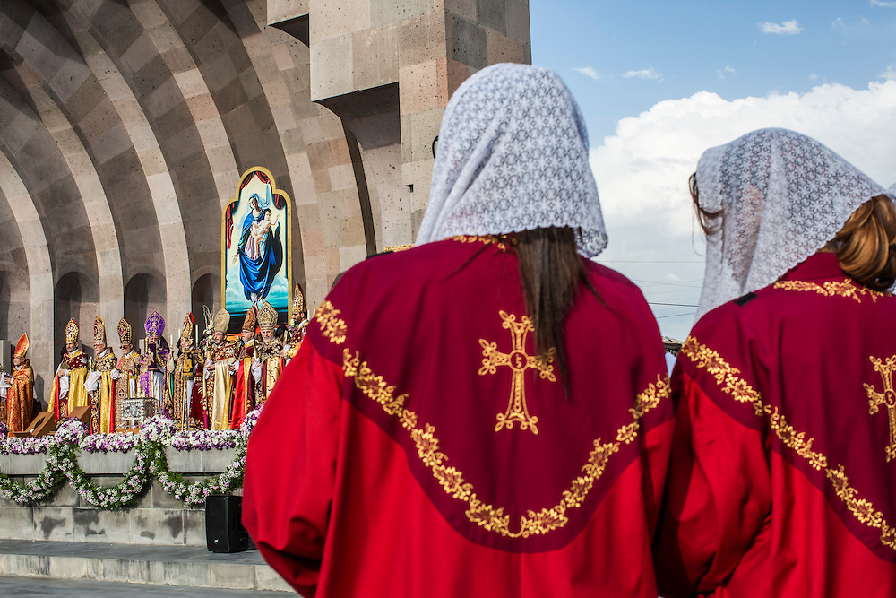 VAGHARSHAPAT, ARMENIA - APRIL 23: Armenian Apostolic Church leaders conduct a canonization ceremony for victims of the Armenian genocide at the Mother See of Holy Etchmiadzin, a complex that serves as the administrative headquarters of the Armenian Apostolic Church, as members of a choir watch on April 23, 2015 in Vagharshapat, Armenia. Tomorrow will mark the one hundredth anniversary of events generally considered to be the start of a campaign of genocide against minority ethnic Armenians living in present-day eastern Turkey by the Ottoman government over fears of their allegiance during World War I. (Photo by Brendan Hoffman/Getty Images) *** Local Caption ***