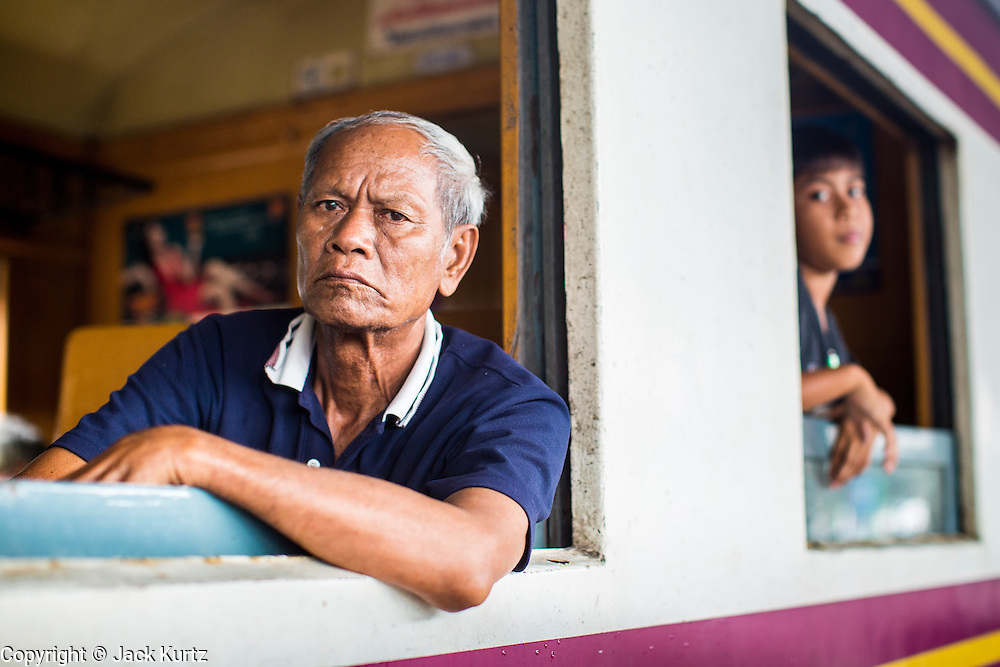 17 APRIL 2013 - BANGKOK, THAILAND: A man waits for a train to leave Hua Lamphong Train Station in Bangkok after Songkran. Songkran, the traditional Thai New Year, is the busiest time of the year for Thai domestic travel. Many people in Bangkok return to their home provinces for the holiday and some people in the provinces travel to Bangkok for the holiday. Songkran, usually a three day holiday, was five days this year because the official days on the weekend. Trains and buses coming into Bangkok were reported to be fully booked and the State Railway of Thailand added extra trains and carriages to accommodate the crowds.    PHOTO BY JACK KURTZ