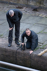 """© Licensed to London News Pictures . 06/10/2013 . Manchester , UK . Specialist police divers examine the find . Police pull a body from The Bridgewater Canal in Manchester , adjacent to the City's """" Gay Village """" . The body was spotted yesterday (6th October) afternoon and a cordon was erected as specialist police divers made the recovery . Photo credit : Joel Goodman/LNP"""