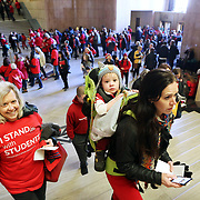 Sarah Swoffer, a teacher in Bend, climbs up to the Senate chamber with her son Thomas on her back. With her is her mom Anne Grinyer, an occupational therapist.<br /> Thousands of educators and their supporters from all over the state gather at the Oregon State Capitol to rally for adequate school funding. A select group of teachers and staff members spoke to Gov. Kate Brown about their experiences, and shared with her the challenges of being a teacher today.<br /><br />Photography by Thomas Patterson.