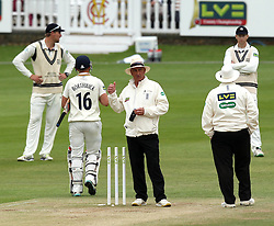 Umpires Neil Bainton and Peter Hartley signal to go off for bad light at the end of day three of Durham vs Middlesex - Photo mandatory by-line: Robbie Stephenson/JMP - Mobile: 07966 386802 - 04/05/2015 - SPORT - Football - London - Lords  - Middlesex CCC v Durham CCC - County Championship Division One